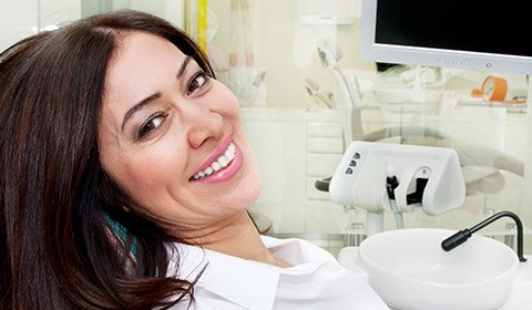 Smiling woman in treatment room