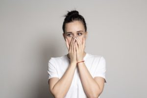 worried woman covering mouth